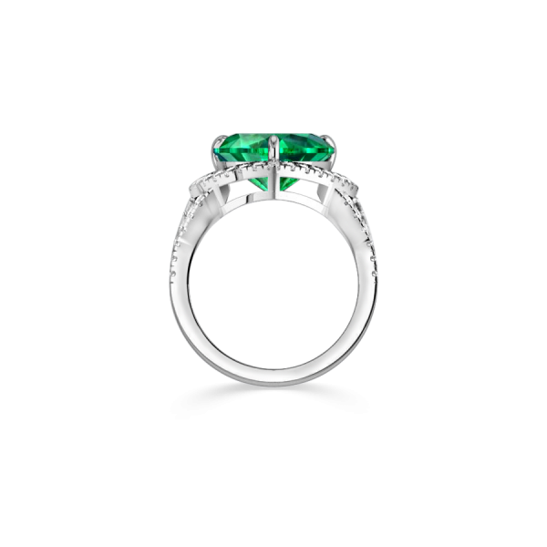 white gold emerald engagement ring with diamonds